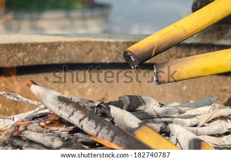 Burning incense sticks at a Buddhist temple - stock photo