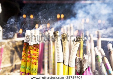 Burning incense sticks at a  temple - stock photo