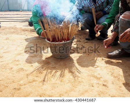 Burning Incense sticks for the altar. - stock photo