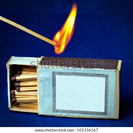 Burning match and boxes of matches - stock photo