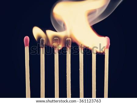 Burning matches on black background - stock photo