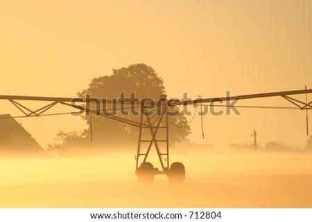 Burning off the fog at sunrise - stock photo