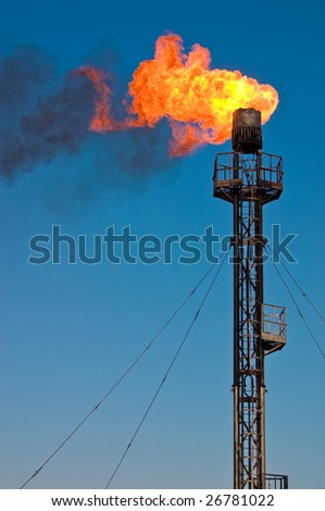 Burning oil gas flare - stock photo
