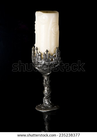 burning old candle vintage silver candlestick.  - stock photo
