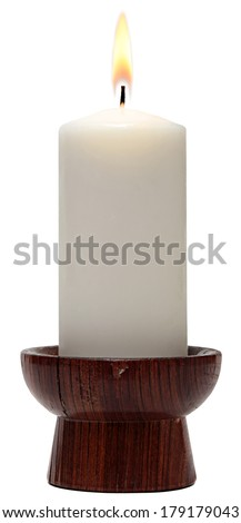 burning old candle vintage wooden candlestick. Isolated on a white background.  - stock photo