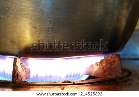 Burning on a gas stove in the kitchen - stock photo