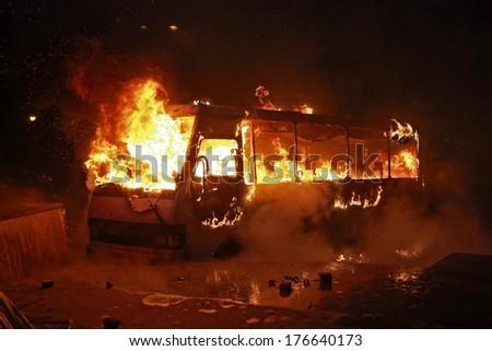Burning police bus. Kyiv, Ukraine, January 19, 2014 - stock photo