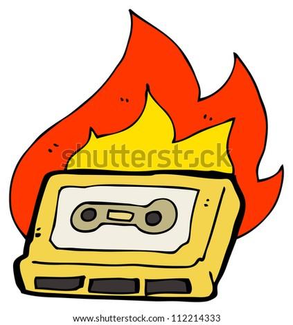 burning retro cassette tape - stock photo