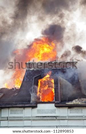 Burning roof - stock photo