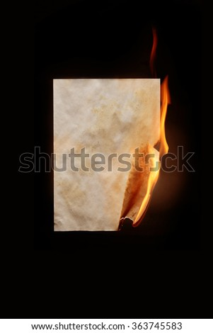 Burning sheet of paper - stock photo