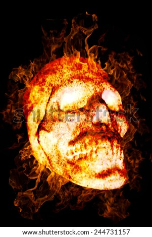 Burning Skull as a symbol of the dead or dangers. Isolated on a black background - stock photo