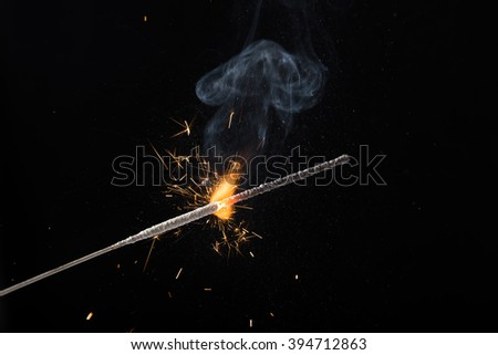 Burning sparkler. Exploding with sparks. Bengal fire. - stock photo
