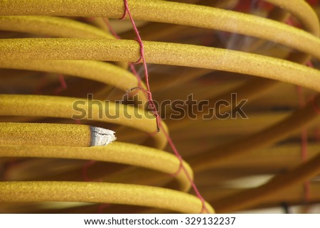 burning spiral incense stick with smoke. Traditional religious rituals in temple. Religion and traditions of East.  - stock photo