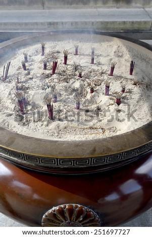 burning stick insense at the japanese temple - stock photo