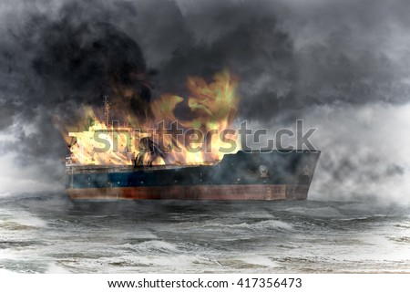 Burning tanker ship on sea at storm. - stock photo