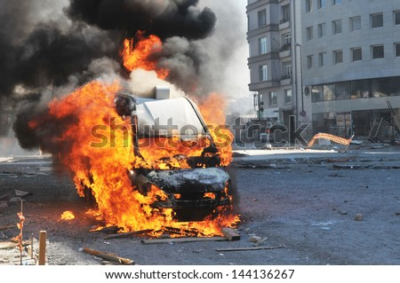 Burning van with large flames and black smoke - stock photo