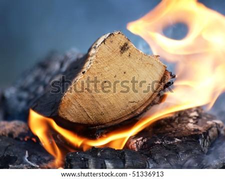 Burning wood, flame and smoke on a bonfire - stock photo