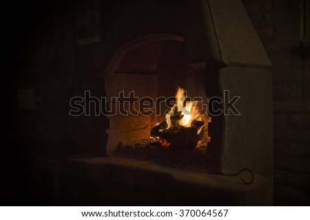 burning wood in open fire place  - stock photo