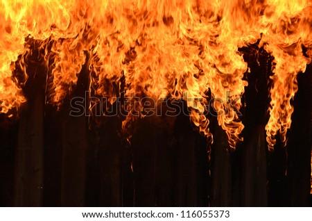 Burning wooden house close-up - stock photo
