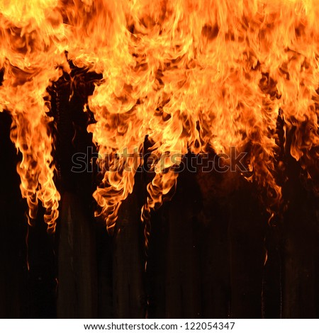 Burning wooden house close-up - stock photo