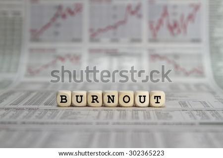 Burnout word built with letter cubes - stock photo