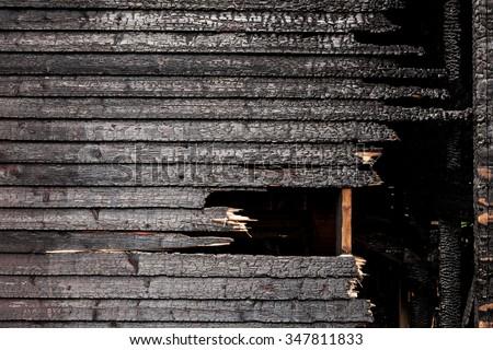 Burnt broken wood wall background texture - stock photo