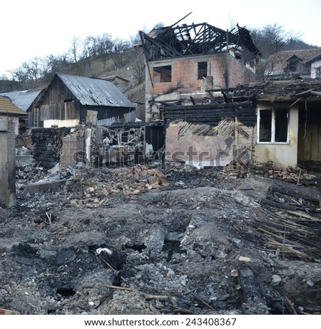 Burnt down house completely damaged by fire - stock photo