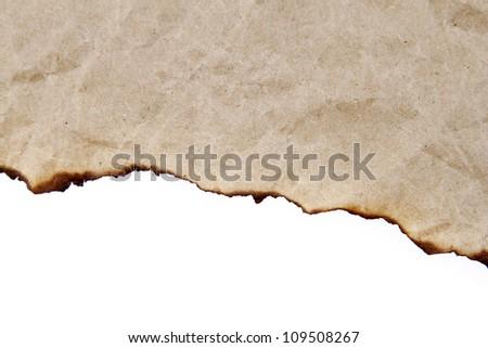 Burnt edge of paper on plain background - stock photo