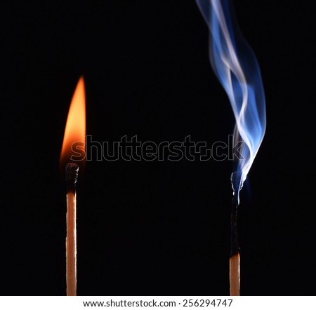 Burnt match in a smoke on a black background. cyan smoke comes out from an extincted match. fire flame match and smoky match - stock photo