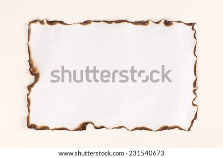 burnt paper sheet edge isolated on white - stock photo