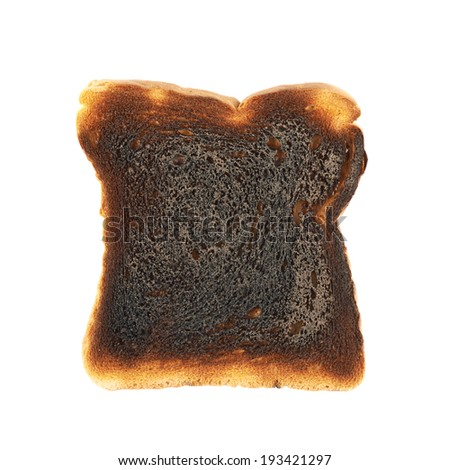 Burnt toast bread slice isolated over the white backround - stock photo
