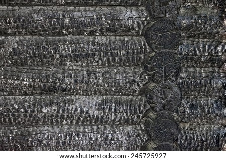 burnt wooden house wall  - stock photo