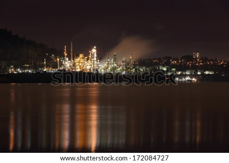 Burrard Inlet Refinery Night, British Columbia. Oil refinery on the shore of Burrard Inlet working through the night. British Columbia, Canada near Vancouver.  - stock photo