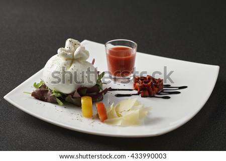 Burrata cheese with strawberry gazpacho sauce and tomatoes - stock photo