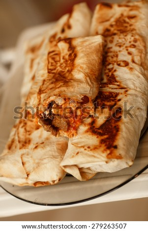 Burrito mexican fast food spicy burritos snack, lunch tortilla, unhealthy eating, selective focus, series. - stock photo
