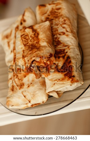 Burrito mexican fast food, spicy burritos snack, lunch tortilli, unhealthy eating, selective focus, series. - stock photo