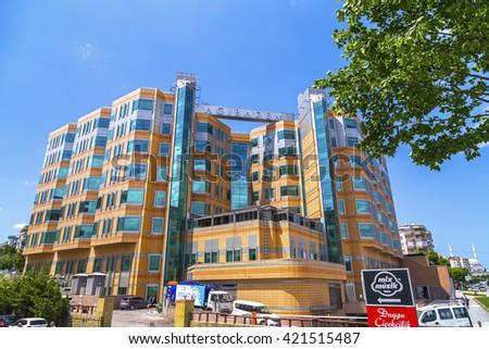 Bursa, Turkey - May 17, 2016: Exterior view of Acibadem Bursa Hospital in FSM district of Nilufer, Bursa, Turkey. Acibadem is a chain hospitals brand. - stock photo