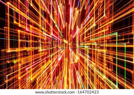Burst of Bright Glowing Lines on Dark Background - stock photo