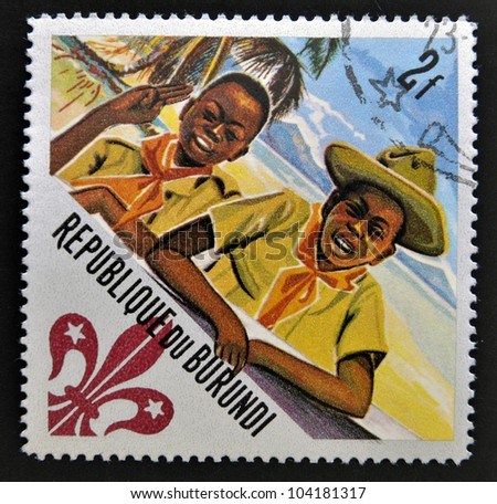 BURUNDI - CIRCA 1967: A stamp printed in Burundi shows Scouts Two scouts, circa 1967 - stock photo