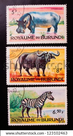 BURUNDI - CIRCA 1970: A stamp printed in Burundi shows three kinds of animals from the hot countries , circa 1970. - stock photo