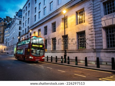 Bus on a streets of London at dusk - stock photo