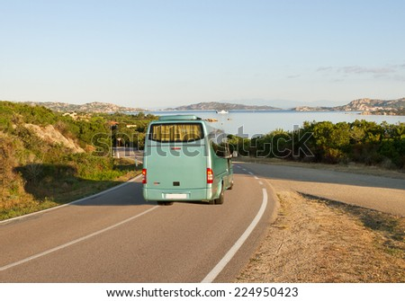 Bus on road next to the Palau, Italy. - stock photo