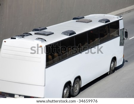 bus rides uphill - stock photo