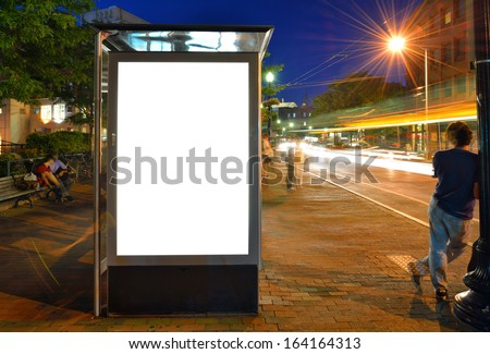 Bus Shelter Billboard at Night - stock photo