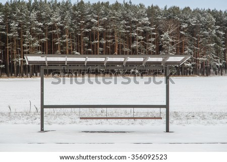 Bus stop on stage forest background winter - stock photo