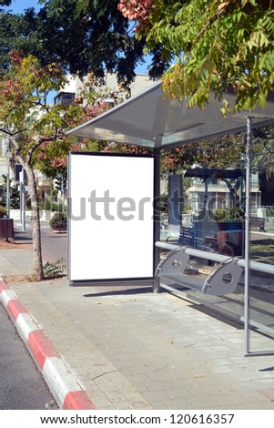 Bus stop with a white blank sign - stock photo