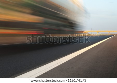 Bus traveling on highway. Motion blur effect. - stock photo