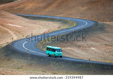 Bus with tourists on Ring road near Myvatn lake, Iceland - stock photo