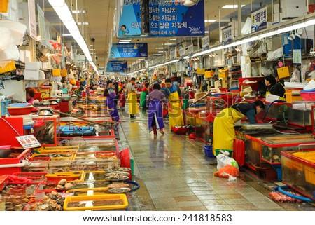 BUSAN, KOREA - OCTOBER 29, 2014 : Activity in the indoor fish market in Jagalchi, Busan, Korea. - stock photo
