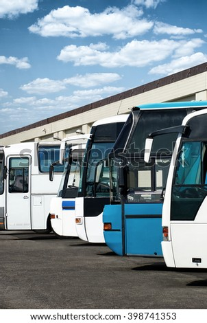 buses at the bus station with cloudy sky - stock photo